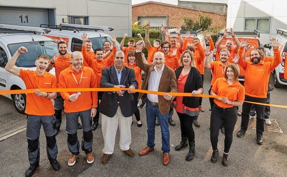 Sir Stelios Haji-Ioannou (pictured centre left) cuts the ribbon on Easy Networks re-branding